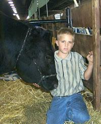 Tyler Halley stands by his prize winning steer.