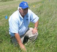 man kneeling in grass